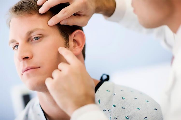 Осмотр врача дерматолога