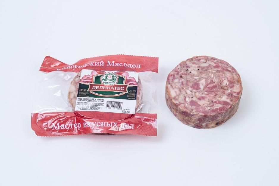 Мясо свиных голов в/к